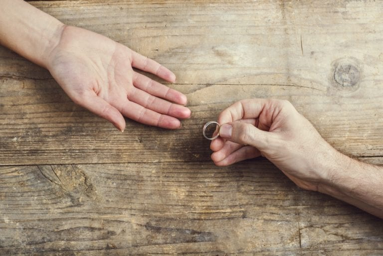 Man offering a ring to a woman.